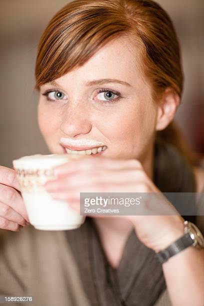 Smiling woman with milk mustache