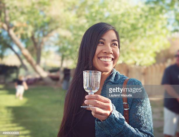 Smiling woman with party wine glass