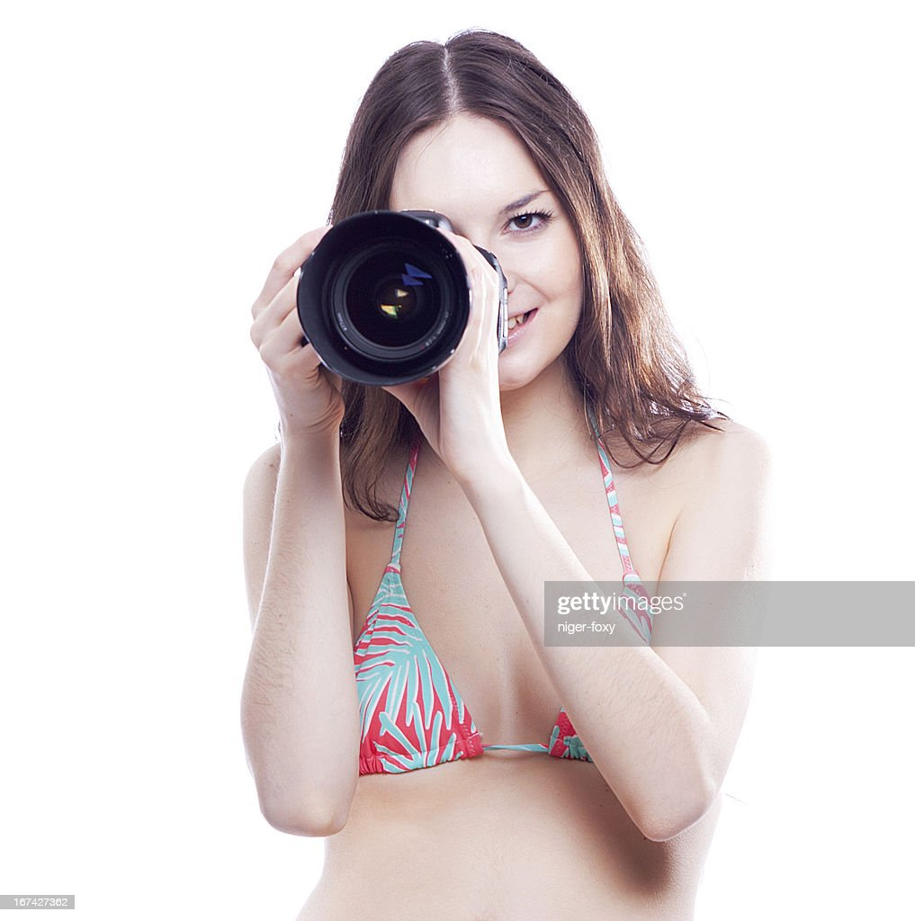 smiling woman with professional camera : Stock Photo