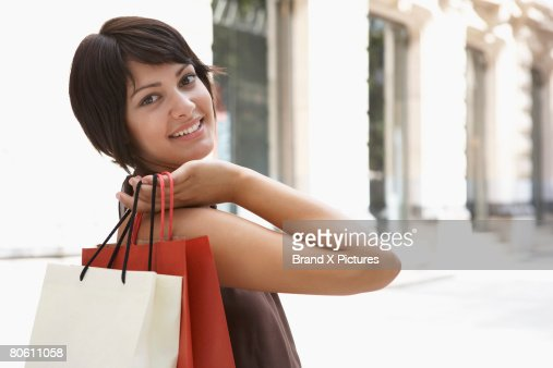 Smiling woman with shopping bags : Stock Photo