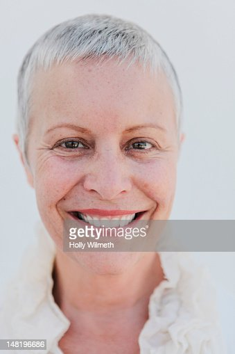 Smiling woman with short gray hair stock photo getty images urmus Gallery