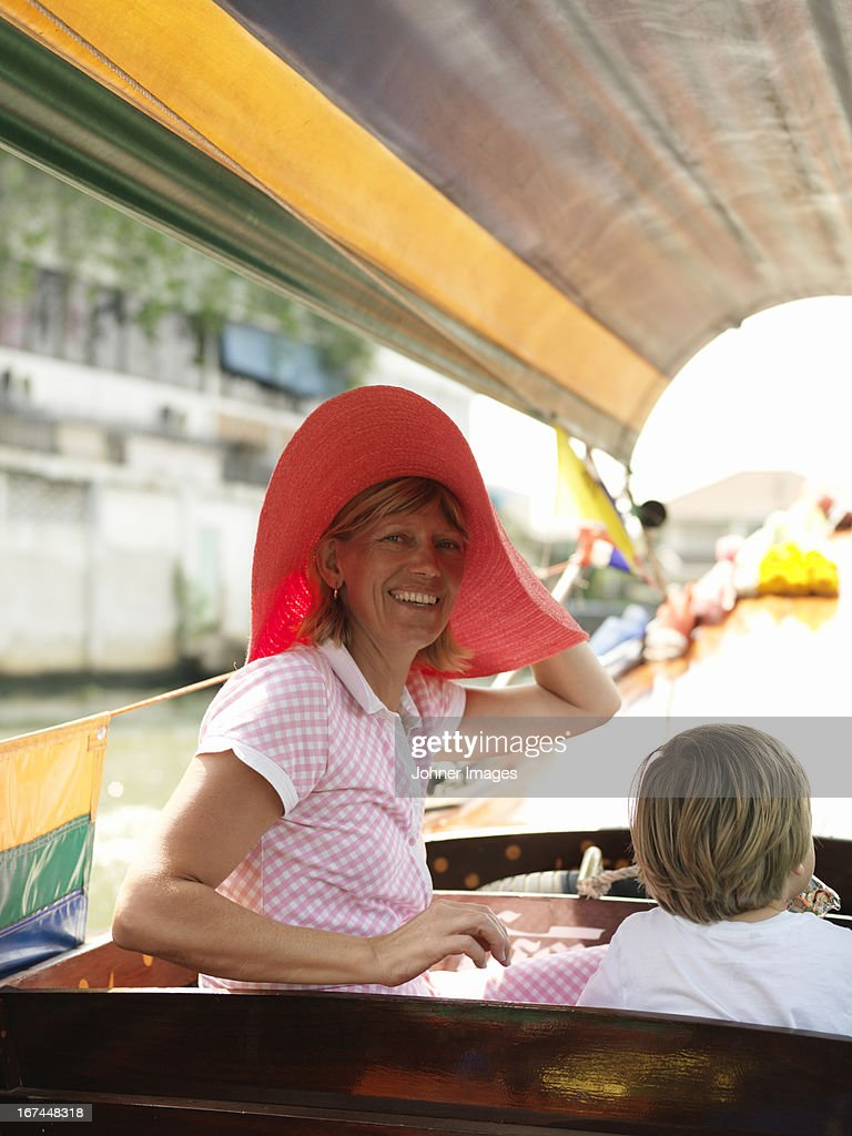 Smiling woman with son on boat : Stock Photo