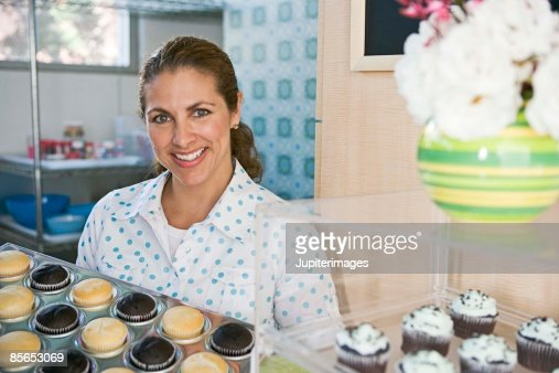 keywords - Woman Decorating Cupcakes