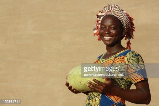 Smiling woman with watermelon : Bildbanksbilder