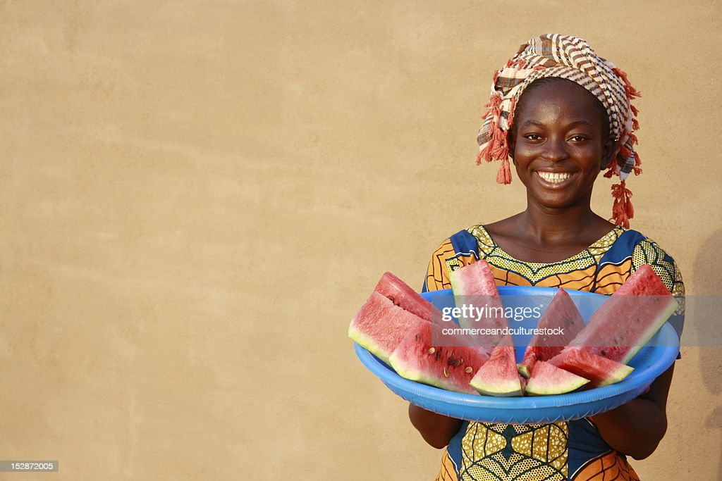 Smiling woman with watermelon : Stock Photo