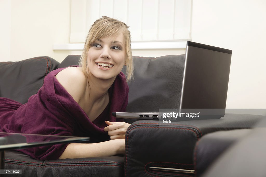 Smiling woman working at home : Bildbanksbilder