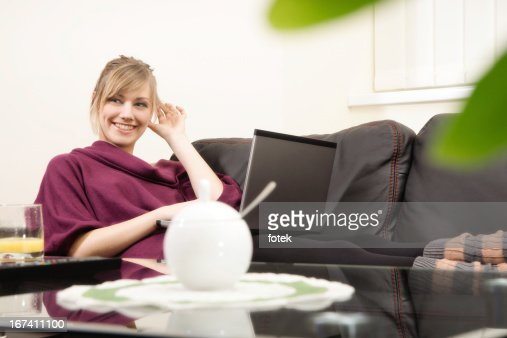 Smiling woman working at home : Stock Photo