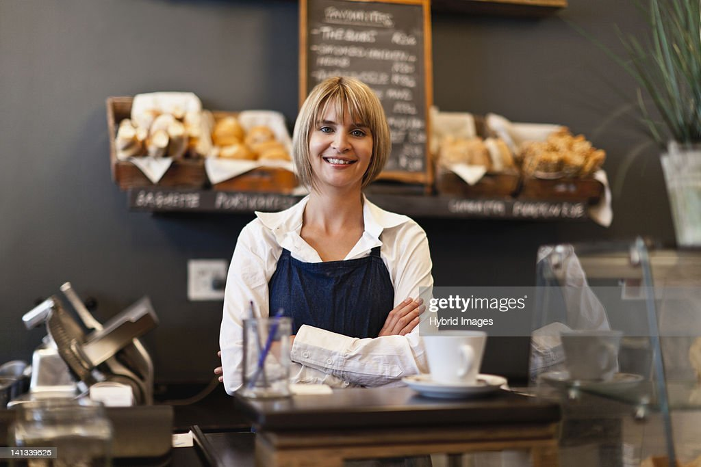 Smiling woman working in cafe : Stock Photo