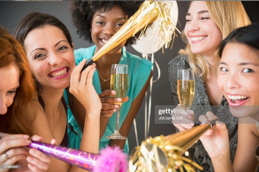 Smiling women celebrating at party : Stock Photo