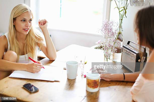 Smiling women having cup of coffee