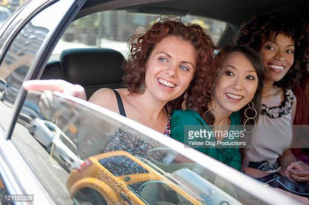 Smiling Women in limousine