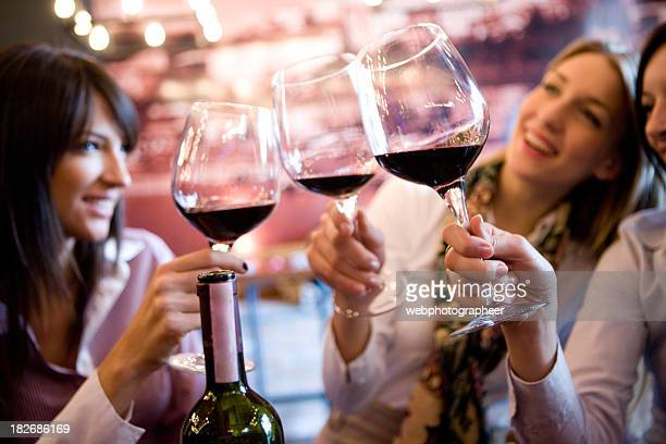 Smiling women making a toast with glasses of wine