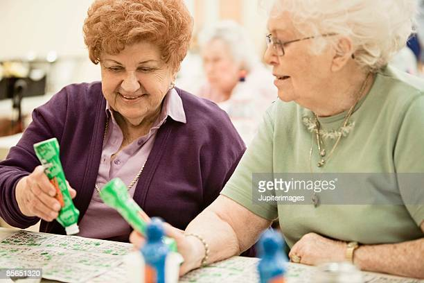 Smiling women playing bingo
