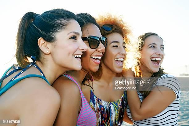 Smiling women posing outdoors