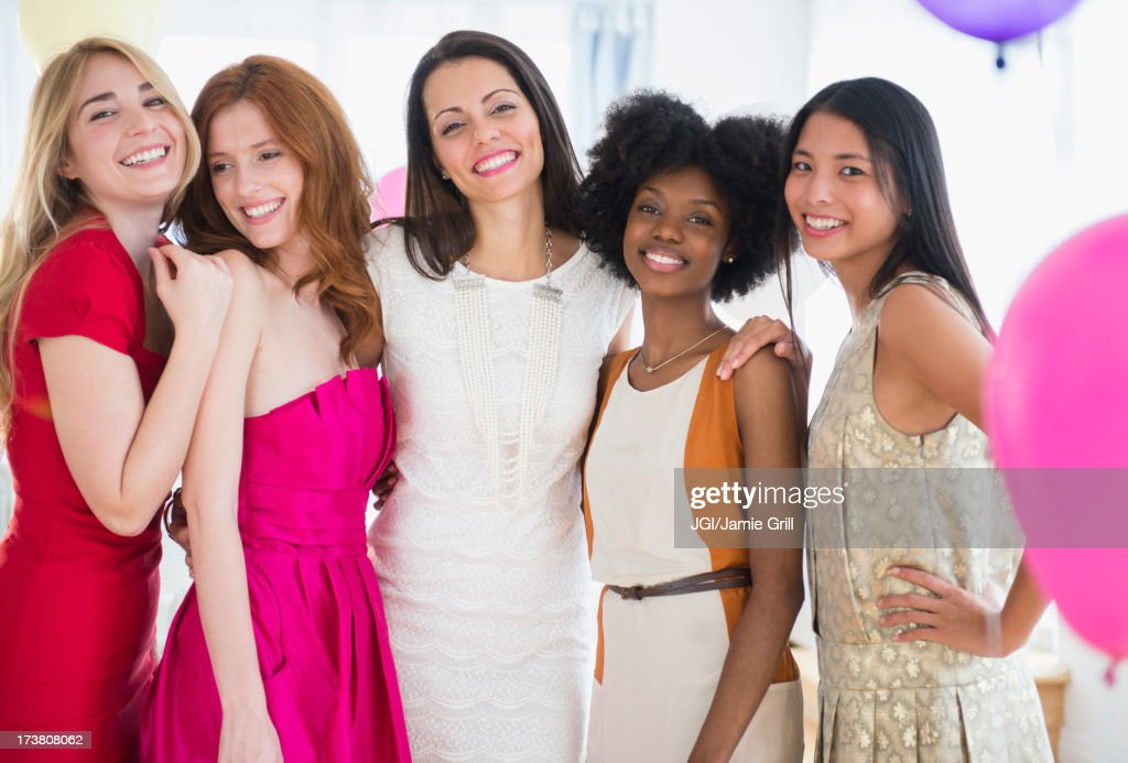 Smiling women standing together at party : Stock Photo