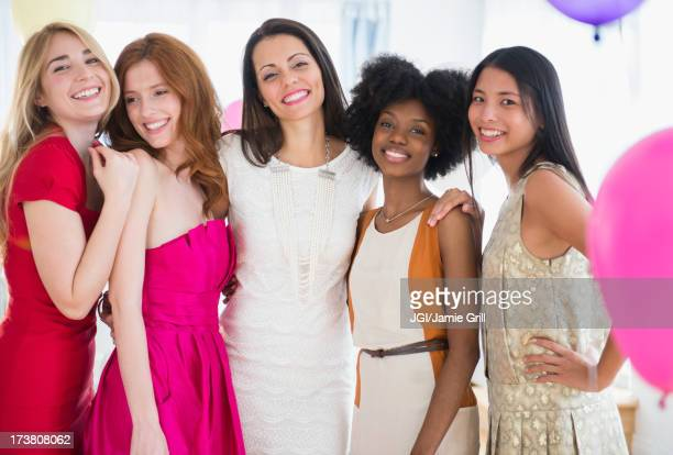 Smiling women standing together at party