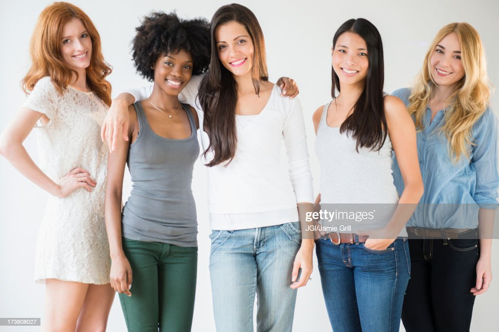 Smiling women standing together