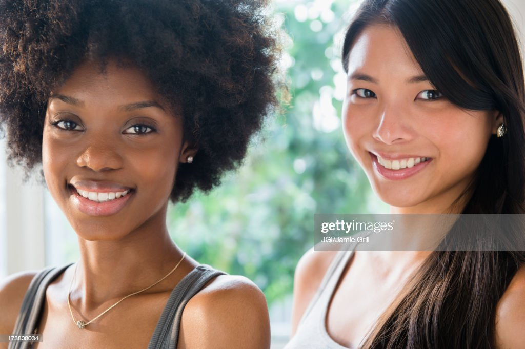 Smiling women standing together : Stock Photo