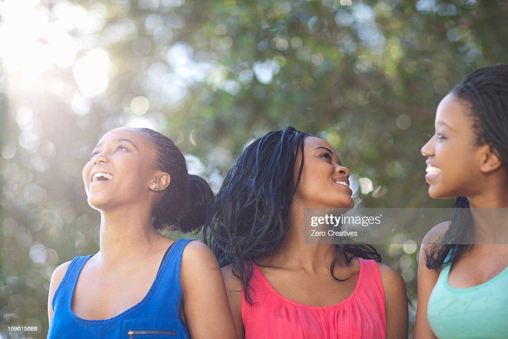 Smiling women walking outdoors : Stock Photo