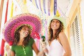 Smiling women with sombreros maracas