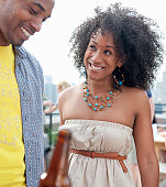 Smiling Young Adult Couple at Rooftop Party