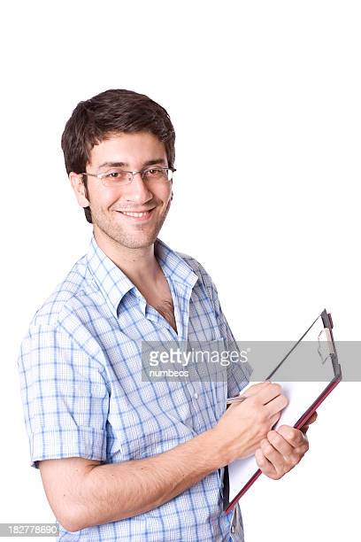 Smiling young adult holding a clipboard