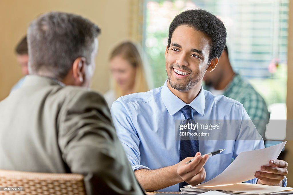 Smiling young adult male at a job interview