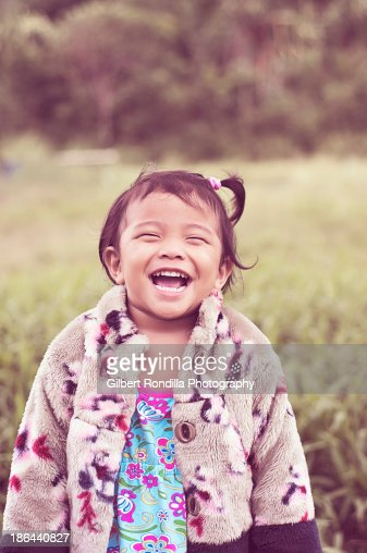 Smiling young Asian girl : Stock Photo