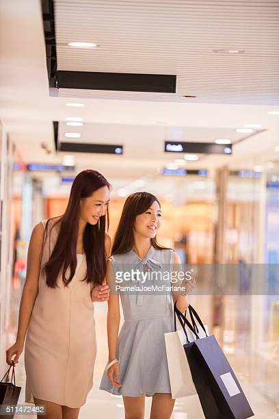 Smiling, Young Asian Women Girlfriends Shopping in Mall, Hong Kong