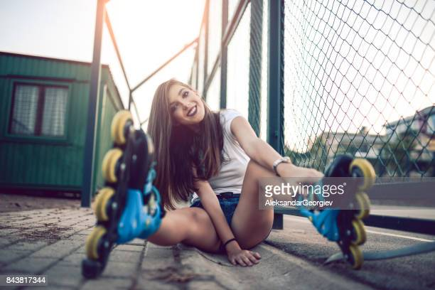 Smiling Young Athlete Female Posing and RollerBlading in Skate Park