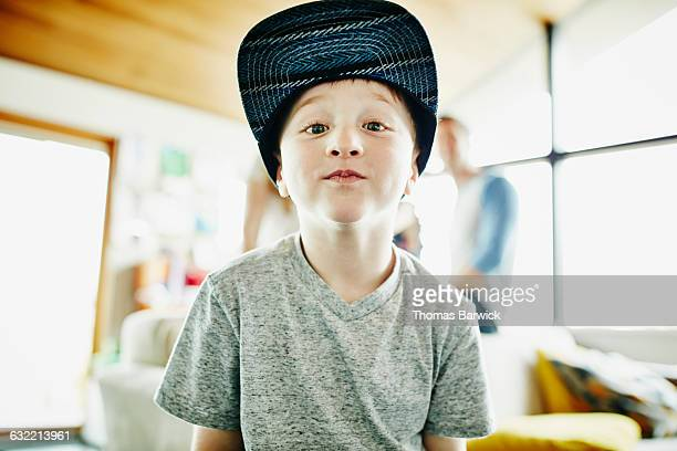 Smiling young boy standing in living room of home