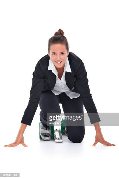 smiling young business woman in starting block