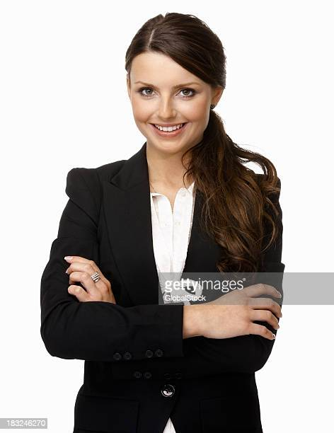 Smiling young business woman with arms crossed against white