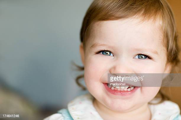 Smiling young child with blue eyes