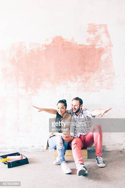 Smiling young couple doing home improvement