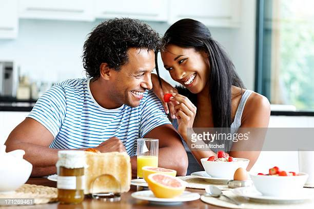 Smiling young couple enjoying breakfast