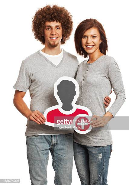 Smiling young couple holding profile image sign isolated on white.