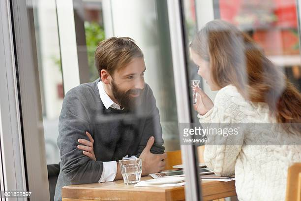 Smiling young couple in restaurant