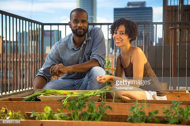 Smiling Young Couple Posing on Rooftop