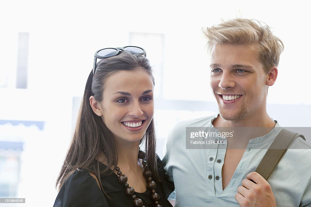 Smiling young couple standing together : Stock Photo