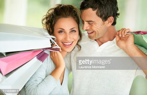 Smiling young couple with shopping bags : Stock Photo