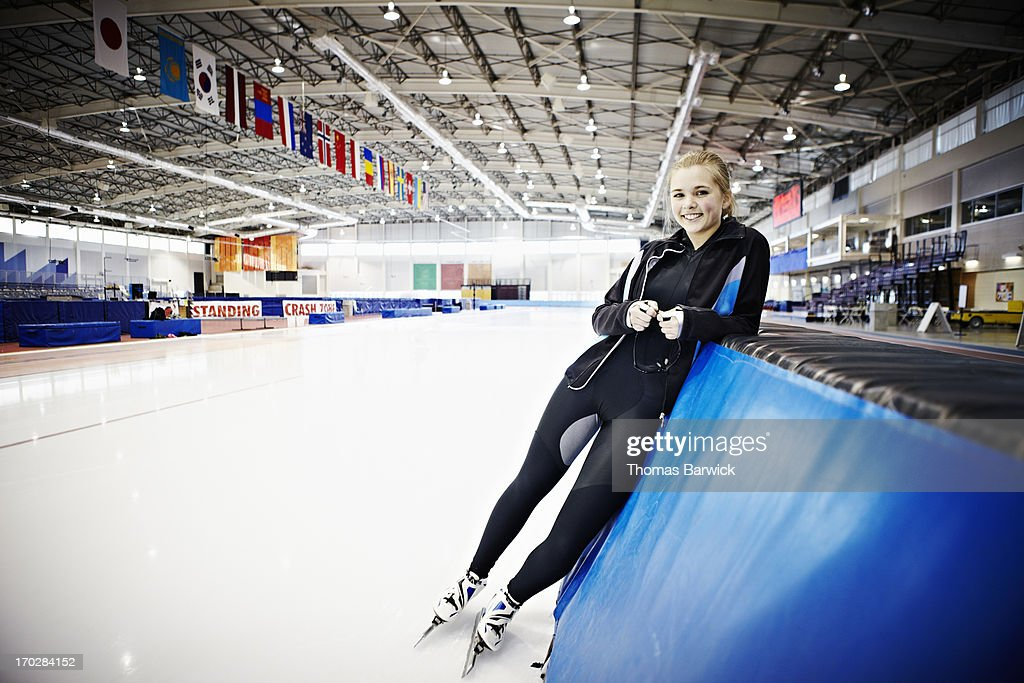 Smiling young female long track speed skater : Stock Photo