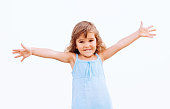Funny little girl with arms outstretched