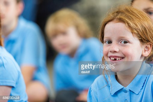 Smiling Young Girl In Class