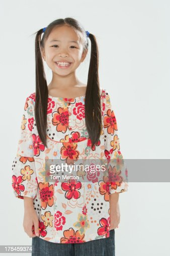 Smiling young girl standing indoors