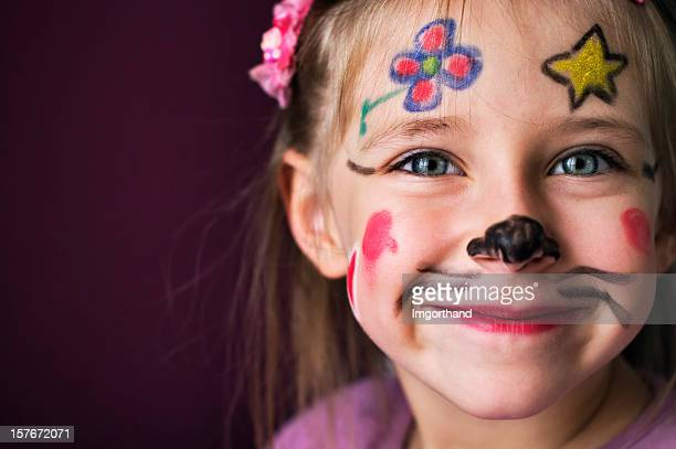 Smiling young girl with a painted face