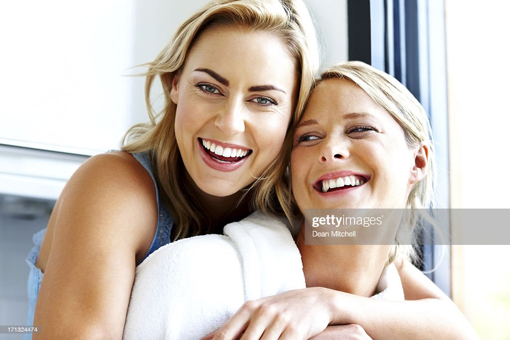 Smiling young homosexual couple together - Indoors