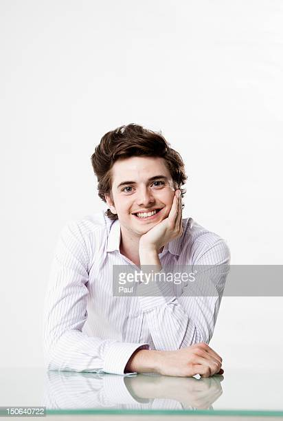Smiling young man at desk