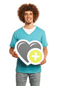 Smiling young man holding heart sign isolated on white background.