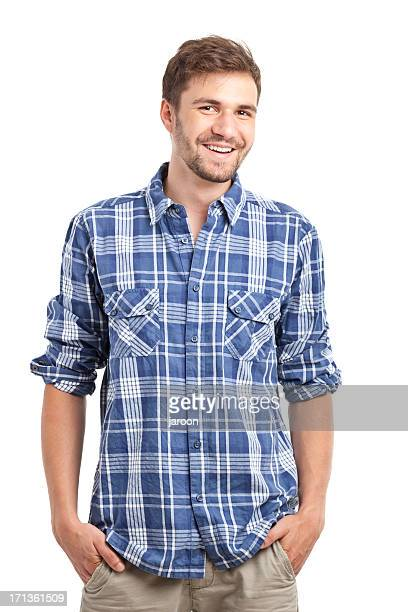Smiling young man in plaid shirt